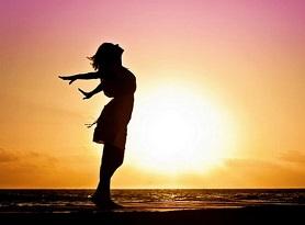 Woman at sunrise happy via pixabay